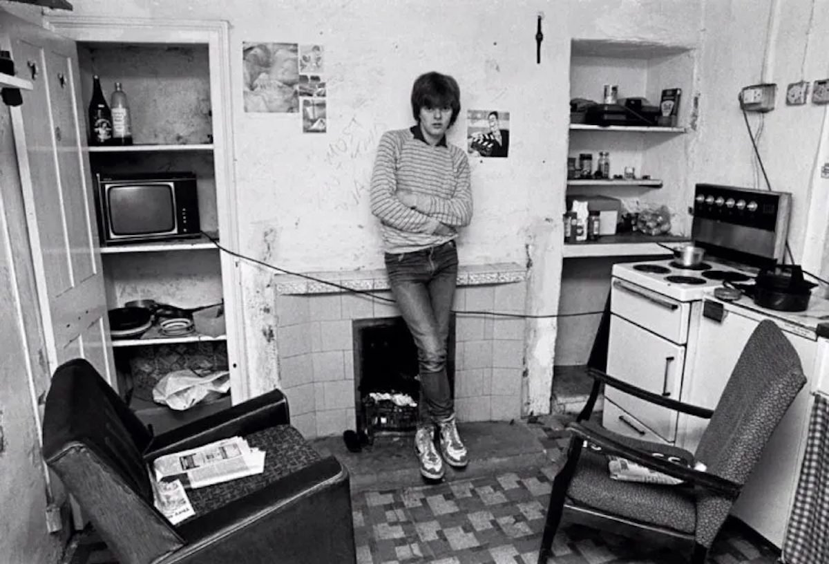 Rob Bremner in his flat. Liverpool, 1980s.