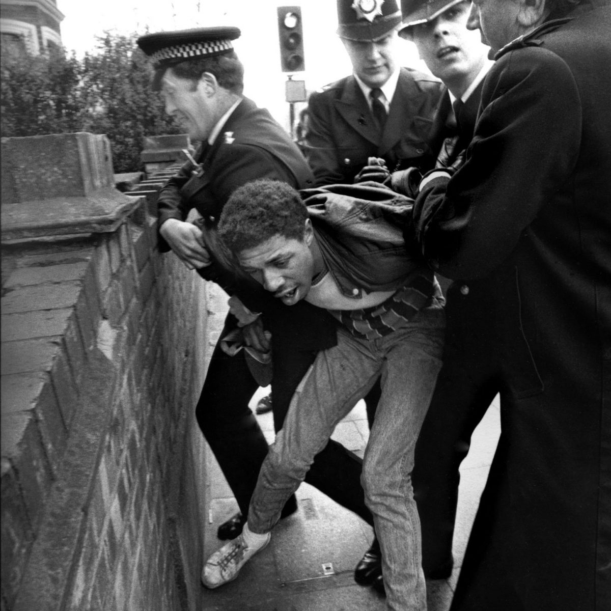 Police make an arrest following a protest against racism in Newham. London, 1985.